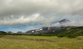 Avacha Volcano or Avachinskaya Sopka in the clouds on Kamchatka Peninsula Royalty Free Stock Photography