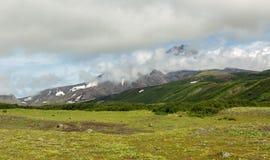 Avacha Volcano or Avachinskaya Sopka in the clouds on Kamchatka Peninsula Royalty Free Stock Image