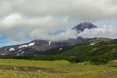 Avacha Volcano or Avachinskaya Sopka in the clouds on Kamchatka Peninsula Royalty Free Stock Photos