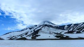 Avacha Volcano. Lenticular lens-shaped clouds above the volcano. Kamchatka Peninsula, Russia stock image