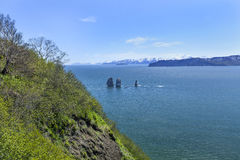 Avachinsky bay and rocks in the spring on Kamchatka Royalty Free Stock Images