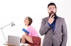 Available online. Blurred student shocked after exam while sexy teacher sitting on desk. Sexi girl surfing Internet royalty free stock photo