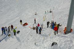 Avalanch rescue search. CHAMROUSSE, FRANCE - JANUARY 27: Rescuers searching for avalanche victims after an accident on the 27th of January, 2014, in Chamrousse Royalty Free Stock Images