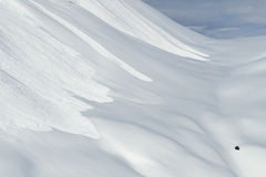 Avalanche. Evidence of several large avalanches on a steep mountainside snowfield Stock Photography