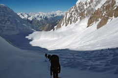 Avalanche!. Avalanche that crosses path behind a group of mountaineers Stock Photo