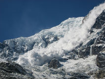 Avalanche from Annapurna. Huge destructive avalanche from Annapurna South from base camp, Nepal stock photography