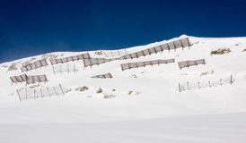 Avalanche barriers in alps mountains Stock Photography