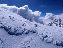 Avalanche clouds fake effect snow covered mountain. Avalanche clouds fake effect in snow covered mountain Stock Images