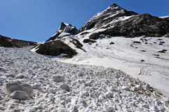 Avalanche course in Troumouse circus in Pyrenees. Coming from Canau pass along the slope of Gabiedou peak. Hautes-Pyrenees, France stock images