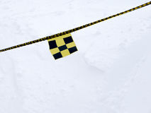 Avalanche danger flag on rope Stock Photos