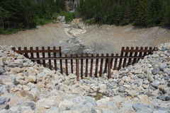 An avalanche gate for rock slides at waterton park, canada. Royalty Free Stock Images