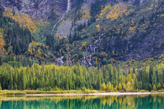 Avalanche Lake. Autumn View of Avalanche Lake With Monument Falls In Background, Glacier National Park, Montana Royalty Free Stock Images