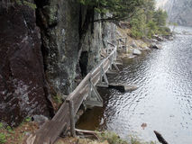 Avalanche Lake Walkway. Foot bridge along a cliff along Avalanche Lake in the the Adirondacks Royalty Free Stock Photos