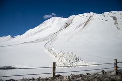 Avalanche near the road Stock Photo