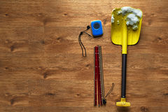 Avalanche rescue kit, lying on  wooden floor. Stock Photo