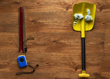 Avalanche rescue kit, lying on wooden floor. Royalty Free Stock Image