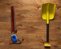 Avalanche rescue kit, lying on  wooden floor. Royalty Free Stock Photos
