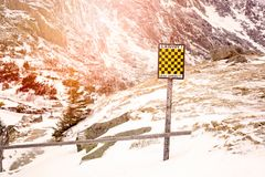 Avalanche sign in winter mountains with snow. Stock Photo