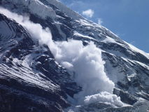 An avalanche at the slope of Dhaulagiri Stock Photos
