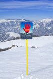 Avalanches sign warning. Avalanches warning sign in ski resort Royalty Free Stock Image