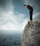 Avalie o risco em um negócio do negócio imagem de stock royalty free