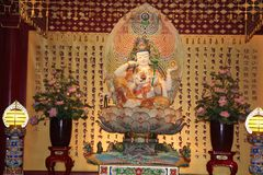 Avalokitesvara In The Form Of Cintamani Wheel. The statue of Avalokitesvara In The Form Of Cintamani Wheel is located in the main prayer hall of Buddha Tooth Stock Photos