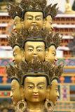 Avalokitesvara statue. Details of a golden statue with faces of the Buddhist god, Avalokitesvara Royalty Free Stock Image