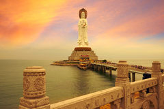 The Avalokitesvara statue, magical sunset. The great Guanyin/Avalokitesvara statue,  landmark of city Sanya, Hainan, China Royalty Free Stock Images