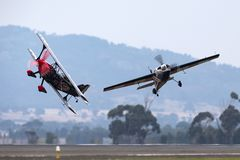 Melissa Andrzejewski flying an Edge 540 aerobatic aircraft with Skip Stewart flying in Pitts Special S-2 aircraft. Avalon, Australia - February 26, 2013 stock images