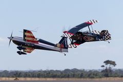 Melissa Andrzejewski flying an Edge 540 aerobatic aircraft with Skip Stewart flying in Pitts Special S-2 aircraft. Avalon, Australia - March 1, 2013: Melissa royalty free stock image