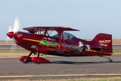 13 Time Australian Aerobatic Champion Chris Sperou flying his Pitts S-1-11B Super Stinker aerobatic biplane VH-XPS. Avalon, Australia - March 3, 2013: 13 Time stock photography