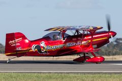 13 Time Australian Aerobatic Champion Chris Sperou flying his Pitts S-1-11B Super Stinker aerobatic biplane VH-XPS. Avalon, Australia - March 2, 2013: 13 Time stock photography