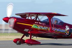 13 Time Australian Aerobatic Champion Chris Sperou flying his Pitts S-1-11B Super Stinker aerobatic biplane VH-XPS. Avalon, Australia - March 2, 2013: 13 Time royalty free stock photography