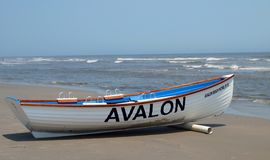 Avalon Beach Patrol Boat. A beach patrol boat rests on the shore in Avalon, New Jersey welcoming visitors back after Hurricane Sandy devastated parts of the area Royalty Free Stock Image