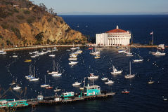 Avalon Harbor on Catalina Island. Classic view of Avalon with casino and boat moorings. Beach cities of Los Angeles county can be seen on the horizon stock photos