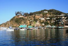 Avalon Harbor Eastern View. Boats in Avalon Harbor, Catalina Island, California, with sky, hills and houses in the background Stock Images