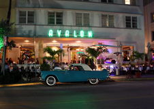 Avalon Hotel at night. SOUTH BEACH, MIAMI-Avalon Art deco  hotel at night with green neon lights with an old Thunderbird in front on Ocean Drive South Beach Stock Photography