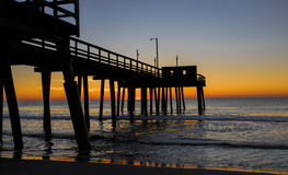 Avalon, New Jersey Dawn Breaks. Dawn breaks over the Atlantic Ocean with Avalon, New Jersey fishing pier in foreground royalty free stock photos