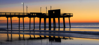Avalon, New Jersey Dawn Breaks. Dawn breaks over the Atlantic Ocean with Avalon, New Jersey fishing pier in foreground Stock Photography