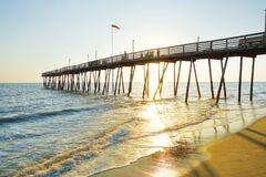 Free Avalon Pier And Beach At The Outer Banks Of North Carolina At Sunrise Stock Photo - 199407440