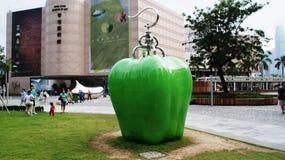 Avangard apple sculpture. Green apple, an avangarde sculpture in Hong Kong Stock Photos