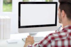Avant de jeune homme d'ordinateur Image libre de droits