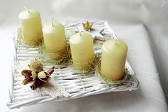 Avantgarde home made advent wreath with line of yellow candles Royalty Free Stock Photos