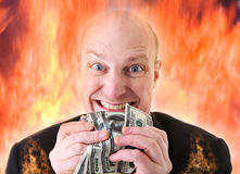 Avarice deadly sin of greed dollars. Avarice, businessman with money. man or devil holding dollars in display of greed in hell fire. A Deadly sin stock image