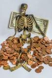 Avaricia para el dinero, esqueleto Foto de archivo libre de regalías
