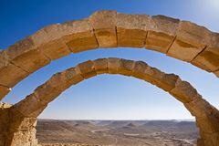 Avdat National Park. Avdat placed in the Negev highlands at the edge of Avdat plateau - Israel. The arcs are part of the southern villa in the old city of Avdat Royalty Free Stock Photography