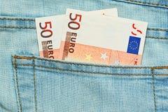 Avdrag eller lön i jeansfack Royaltyfri Foto