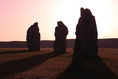 Avebury stone circle. Avebury standing stones in the mist at sunrise. Avebury, Wiltshire, England Stock Image
