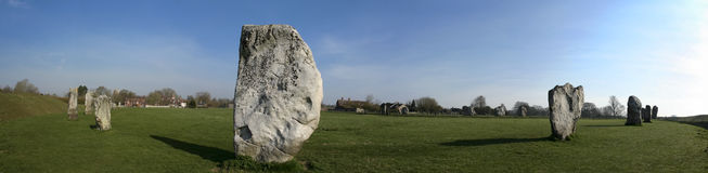 Avebury stone circle wiltshire england. Panorama of standing stones in the prehistoric stone circle surrounding avebury village in wiltshire england Stock Photos