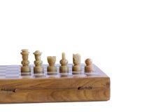 Avec des morceaux d'un jeu d'échecs d'isolement Photographie stock libre de droits